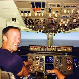Bryan Herb prepares to fly a 767 simulator.